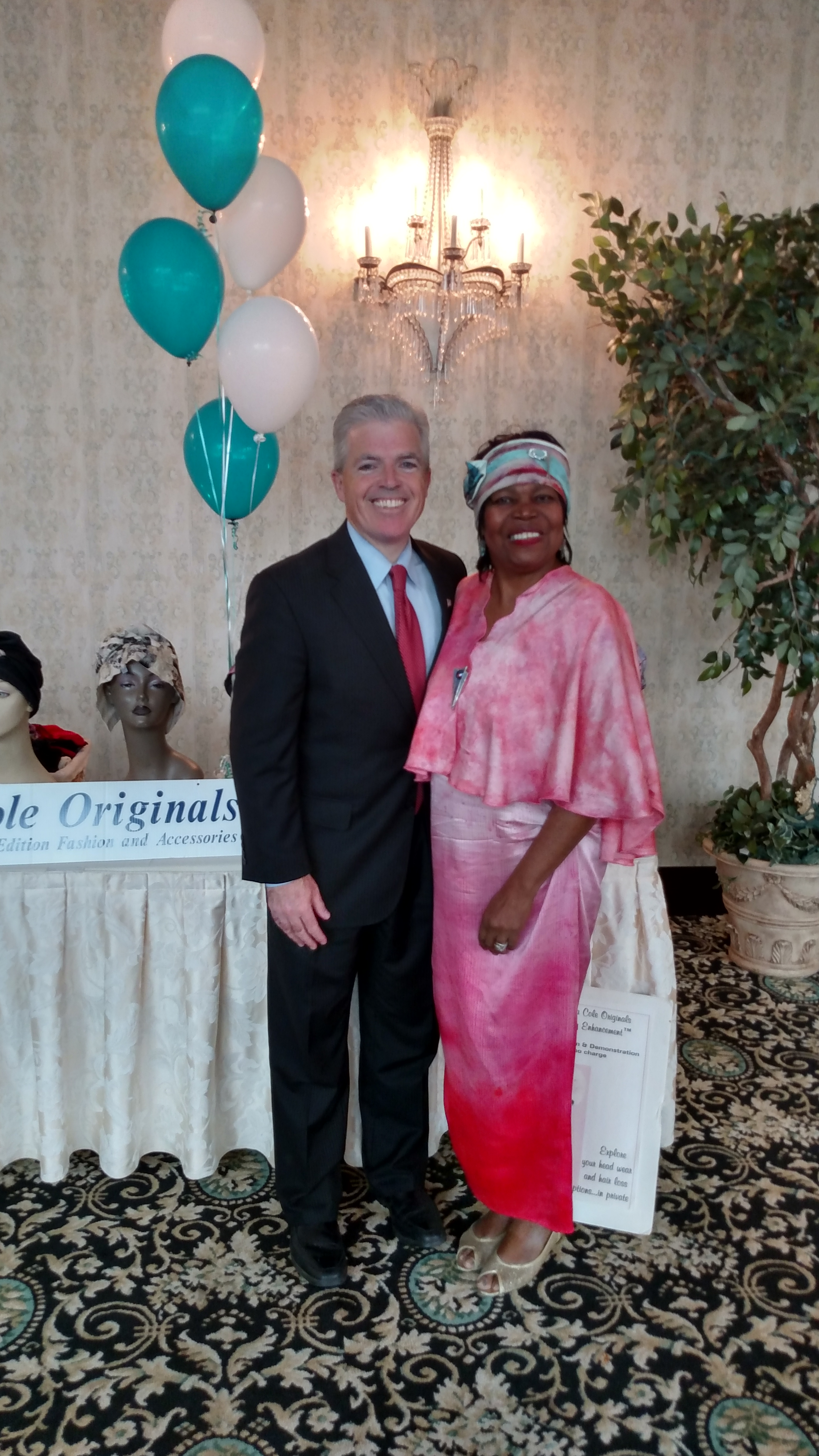 Suffolk County Executive Steve Bellone Stops by Madona Cole Originals Dignity Headwear Display Table at East Wind Inn